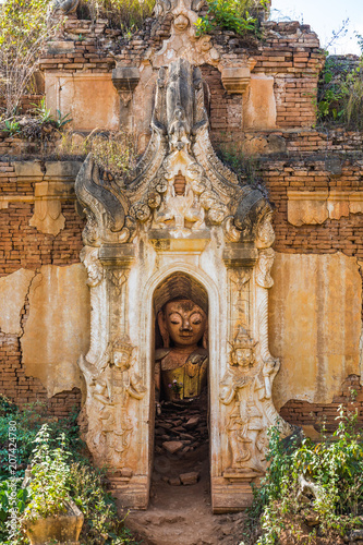 Fotobehang Asia land Buddha statue hiding in the ruins of the Shwe Inn Dein Pagoda at Inle Lake Shan state in Myanmar (Burma)
