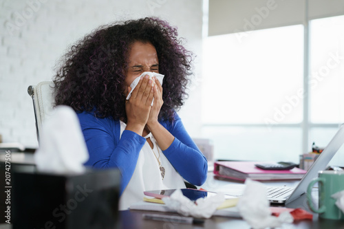 Fotografia  Black Woman Working from Home And Sneezing For Cold