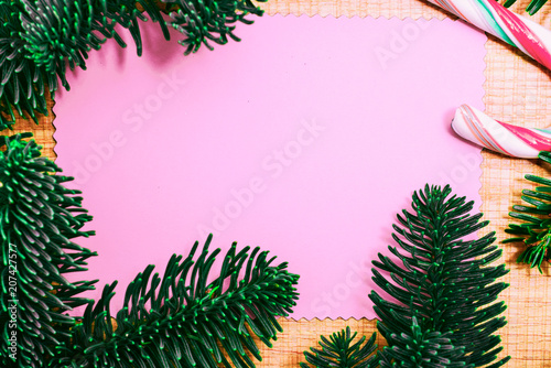 Christmas candy cane and fir tree branch on wooden background  Xmas