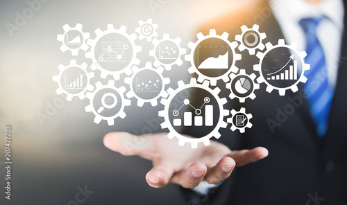Fototapeta Gear cogs is connected to financial charts, KPI, and graphs. Business Process Data Analysis concept obraz