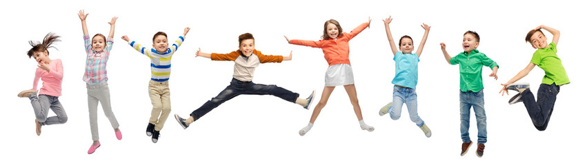 Fototapeta happiness, childhood, freedom, movement and people concept - happy kids jumping in air over white background