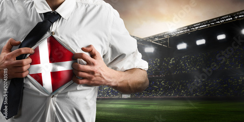 Photo  Denmark soccer or football supporter showing flag under his business shirt on stadium