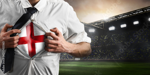 Fotografía  England soccer or football supporter showing flag under his business shirt on stadium