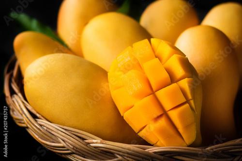 Obraz na plátně Yellow Mango Beautiful skin In the basket Blackboard background