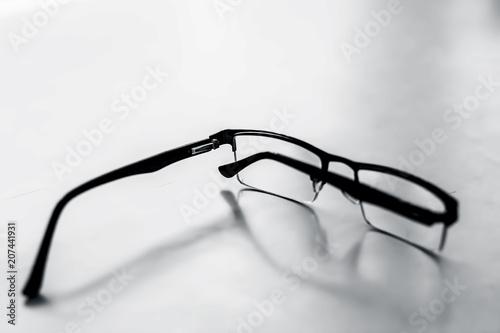 Fotografía  Black colored half frame rim reading glasses or spectacles to cure eye disease myopia