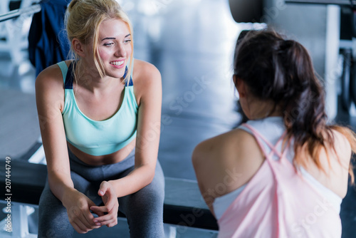 Fotoposter Ontspanning happiness healthy fit and firm girlfriend enjoy meeting with fun talk after workout in gym
