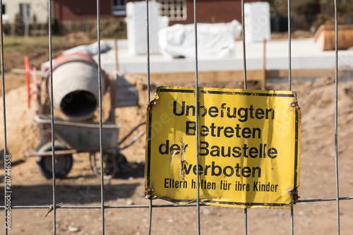 Fotografie, Obraz  sign with german text unbefugten betreten der baustelle verboten Eltern haften f