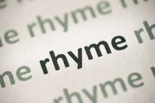 Word Rhyme Printed On Paper Macro