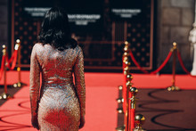 Woman In A Luxurious Dress On A Red Carpet
