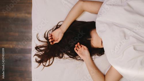 Obraz Woman sleeping on bed - fototapety do salonu