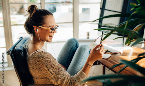 Canvas Prints Relaxation Woman having fun with her mobile phone
