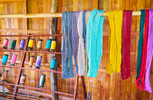 Fotografie, Obraz  Colored yarn in Inpawkhon textile workshop, Inle Lake, Myanmar