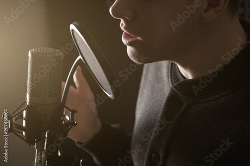 A close photo of the lips of the singing guy at the microphone. Horizontal frame - 207460964