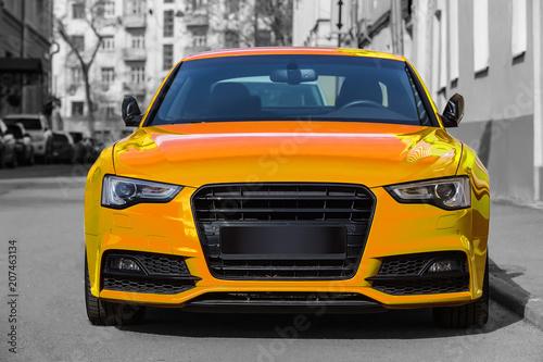 Türaufkleber Schnelle Autos yellow luxury car parked on city