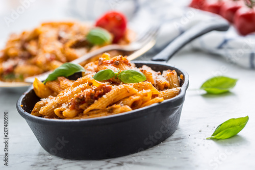 Italian food and pasta penne with bolognese sause in pan