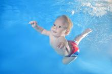 Little Boy Dives Underwater I...