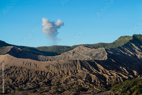Fotobehang Blauw Beautiful view landscape of active volcano crater with smoke at Mt. Bromo, East Java, Indonesia.
