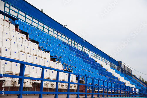 Papiers peints Stade de football Empty white and blue seats in stadium