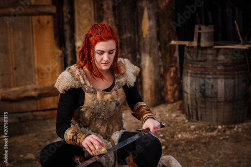 Photo  Red-haired woman is a Viking