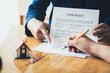 real estate agent holding house to his client after signing contract,concept for real estate,insurance with house, moving home or renting property