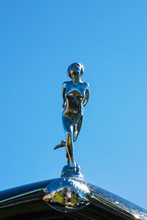 Hood Ornament Of A Woman On A ...