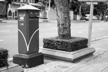 Black And White Photo; Thailand Post Box Beside The Road. In Thai Language Means Bangkok, Other Places.