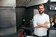 Leinwanddruck Bild - Happy Cook In Restaurant Kitchen