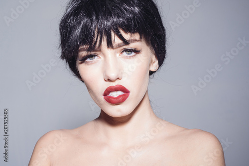 Portrait of young female with black bob hairstyle, sexy red lips Fotobehang