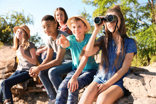 Fototapeta Group of children with binoculars outdoors. Summer camp obraz