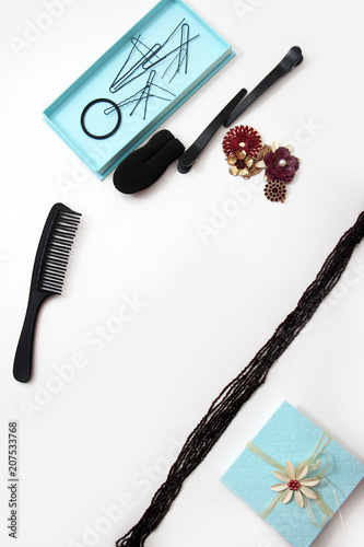 Foto op Plexiglas Kapsalon Smartphone Accessories and hair pins flat lay. Sponge for hair, hairdo babette. necklaces of beads or flowers, tiffany blue boxes made of cardboard. White background with copy space for text.