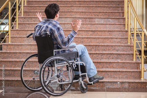 Fotografie, Obraz  Disabled man on wheelchair having trouble with stairs