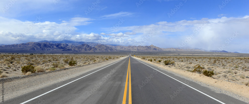 Fototapety, obrazy: Driving on the open road in the desert with mountain backdrop