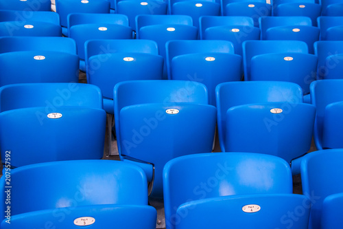 Poster Stadion Rows empty bright blue plastic seats in a stadium