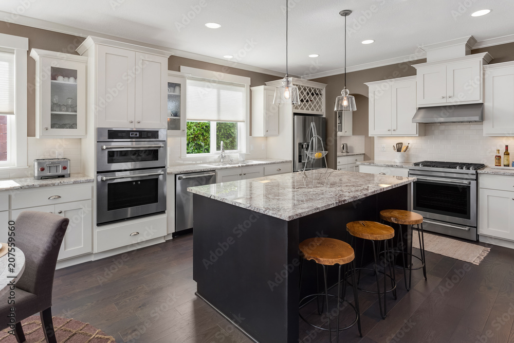Fototapety, obrazy: Beautiful Kitchen in New Luxury Home with Island, Oven, Range, Stainless Steel Appliances, and Refrigerator