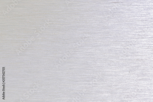 Türaufkleber Metall Close up industrial background of fractally scratched direct horizontal lines to silver metal/stainless steel surface. Creative detail macro photography.