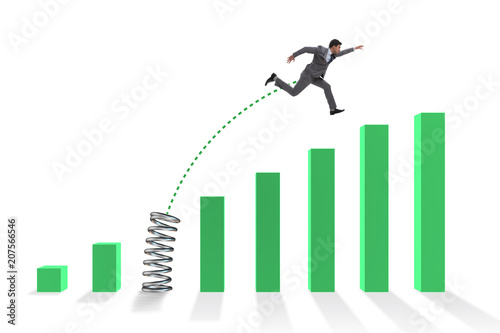 Foto Business people jumping over bar charts
