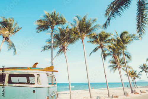 vintage car parked on the tropical beach (seaside) with a surfboard on the roof - Leisure trip in the summer Wallpaper Mural