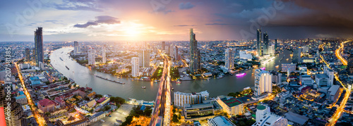 Aerial view of Bangkok skyline and skyscraper with light trails on Sathorn Road center of business in Bangkok downtown Wallpaper Mural