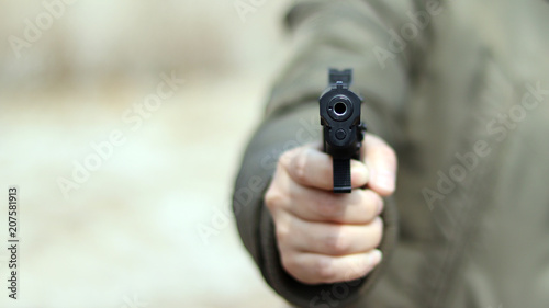 Close-up image of the muzzle of a gun. Fototapete