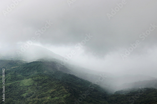 Fotografie, Obraz  Moody fog over mountain scenery in rainy day.