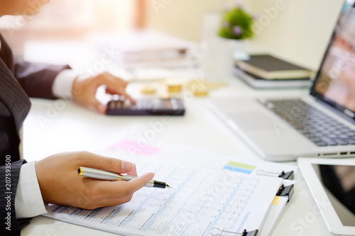 Finance control close up hand analysis financial data in document paper.