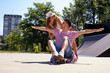 Happy young couple having fun with skateboard in the skate park