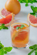 Grapefruit water in a glass with mint