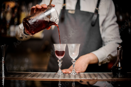 Barman pouring fresh summer Arnaud cocktail into the glasses Canvas Print