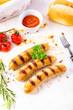 Leinwandbild Motiv delicious bratwurst with ketchup and fresh rolls