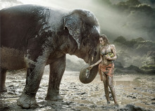 Sensual Tamer Feeding Her Elephant Pet
