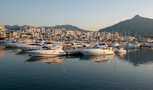 Porto Banus Marina,  Playground Of The Rich And Famous  Super Yachts Moored. May 2018.