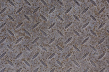 Industrial Wallpaper Of Functional Anti-slip Metal Diamond Plate And Rough Raised Surface Pattern. Creative Background Macro Photography Of Construction For Catwalks, Stairs, Walkway.