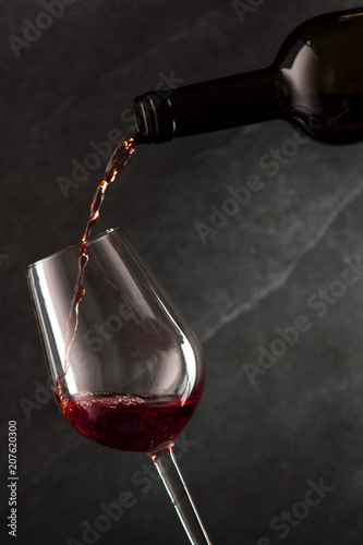 Pouring wine into glass from the bottle
