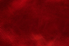Glowing Metallic Red Leather Texture Background. Small Grain